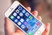 Apple posts record third-quarter as iPhone sales surge