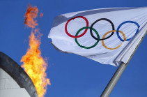 Олимпийский флаг прибыл в Токио