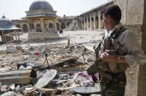Сирийские войск временно приостановили наступление на период вывода мирных жителей из Алеппо