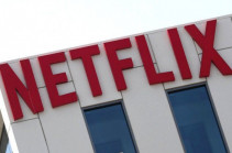 Netflix soars on record subscriber total