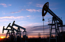 Oil falls below $60 a barrel as inventories stay high