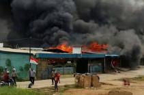 Papua prison break: Hunt for 250 inmates who escaped torched prison
