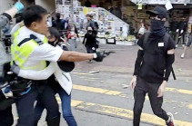 Hong Kong police shoot man in Monday morning rush hour protests