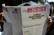 Turkish court sentences to jail seven at opposition newspaper