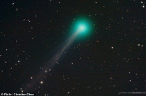 Green-tinged Comet Swan with an 11 million-mile-long tail flies past Earth on its way to the Sun