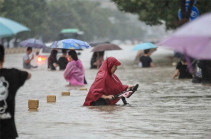 12 dead and thousands evacuated in China floods