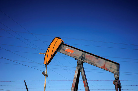 Oil slips back towards 18-month lows on oversupply