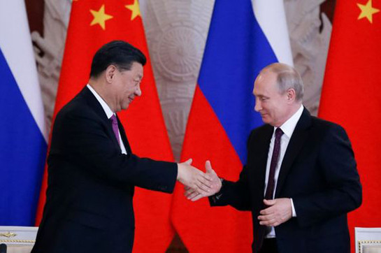 China's Xi praises 'best friend' Putin at some point in Russia appointment