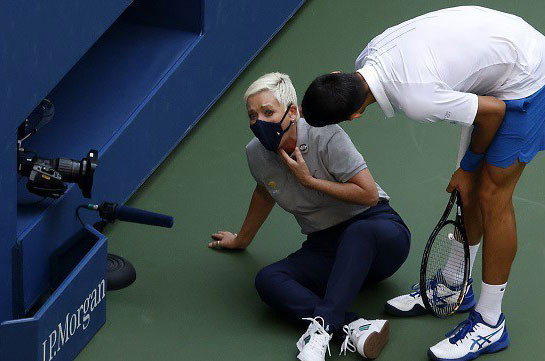 Novak Djokovic apologises after hitting line judge with ball at US Open